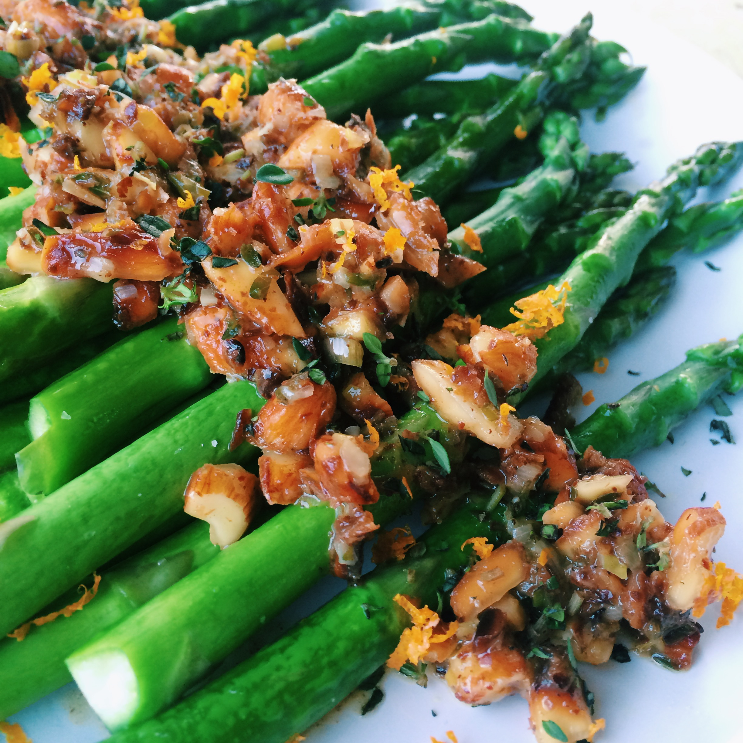 Pan steamed asparagus with an orange-almond sauce: (serves 4)